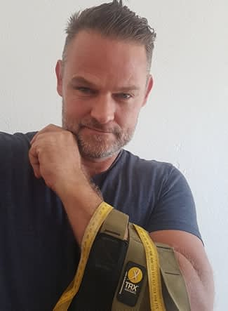 Martin with his favorite workout tool - TRX